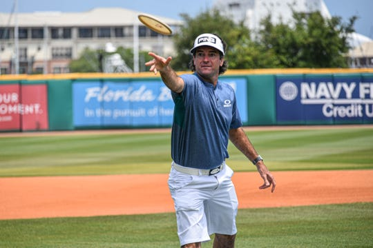 Masters champion and Pensacola Blue Wahoos co-owner Bubba Watson plays disc golf at the unveiling of the course he designed during the COVID-19 pandemic in May 2020.