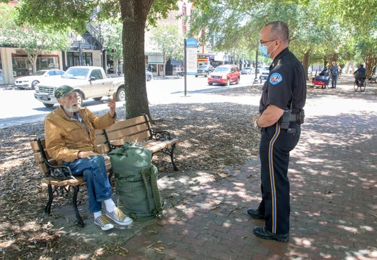 Pensacola Police Department Chief Tommi Lyter, right, chats with Richard Gaff in Martin Luther King Jr. Plaza along Palafox Street in downtown Pensacola on Tuesday, May 11, 2020.  The number of homeless and vagrants in downtown has increased during the coronavirus shutdown.