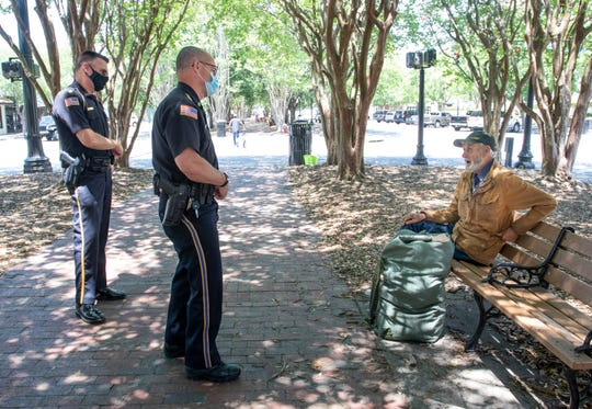 Pensacola Police Department Capt. Stephen Davis, left, and Chief Tommi Lyter talk with Richard Gaff in Martin Luther King Jr. Plaza along Palafox Street in downtown Pensacola on Tuesday, May 11, 2020.  The number of homeless and vagrants in downtown has increased during the coronavirus shutdown.