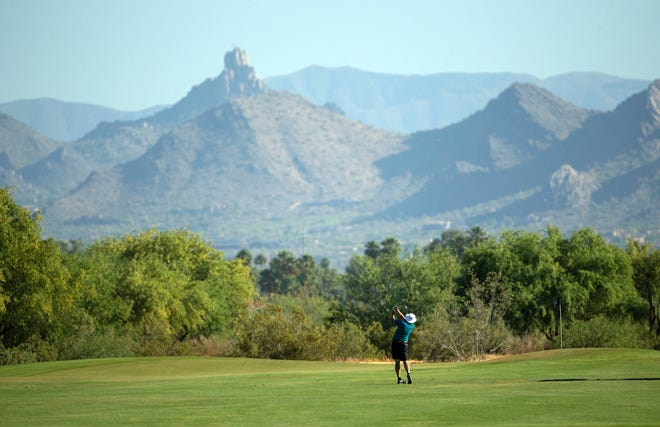May 12, 2020; Scottsdale, Arizona, USA; PGA golfer Kirk Triplett plays his second shot on the 10th hole during round one at the Scottsdale AZ Open at Talking Stick Golf Club's OÕodham course. This is the first semi-significant sports event to take place in the Valley since the sports shutdown in March due to the coronavirus (COVID-19) pandemic. Mandatory Credit: Rob Schumacher-USA TODAY Sports