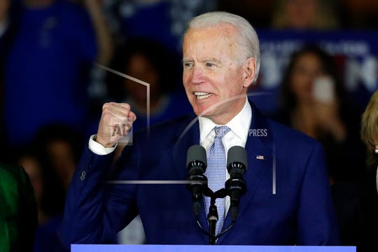In this March 3, 2020, file photo, Democratic presidential candidate former Vice President Joe Biden speaks at a primary election night campaign rally in Los Angeles. Biden would have to do more than select a Latina running mate to win over Hispanics whose support could be crucial to winning the presidency, according to activists who are warning the presumptive Democratic nominee not to take their community for granted.
