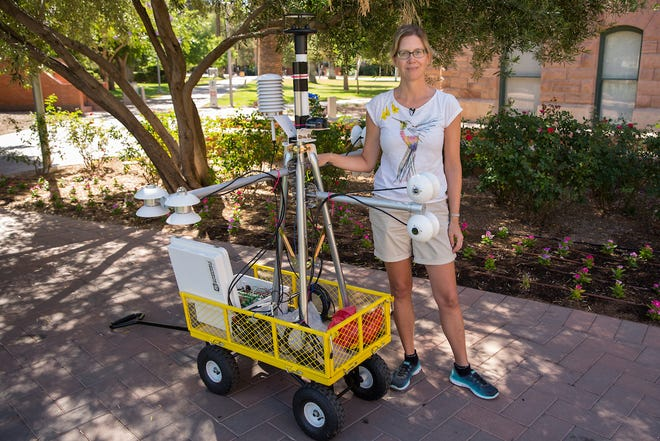 Ariane Middel stands beside one of her MaRTy mobile heat sensing devices at Arizona State University in Tempe.