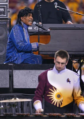 Rock & Roll Hall of Famer Little Richard performed with Arizona State's band during halftime of a Thanksgiving game against USC in 2007. Little Richard died on May 9 at age 87.