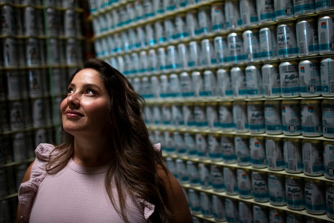 Leah Huss, co-owner of Huss Brewing, poses for a portrait inside the company's brewing facility in Tempe, Ariz. on May 13, 2020. Leah, who runs the company with her husband Jeff Huss, said that despite challenges during COVID-19 they had worked to keep their staff employed throughout.