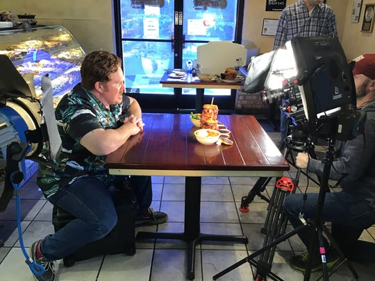 Man V. Food host Casey Webb films an episode at the Scottsdale location of Chompie's. For the Scottsdale episode, Webb visited three restaurants in metro Phoenix.