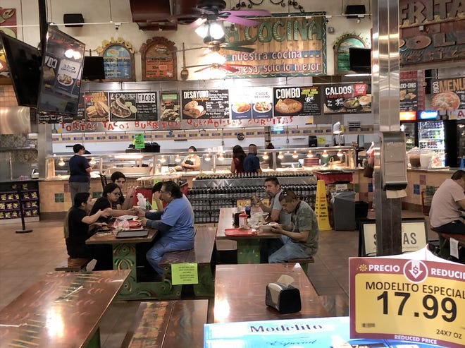 During the Taco Tuesday promotion, the kitchen tables at Los Altos Ranch Market look busy on May 12, 2020.