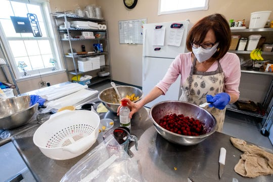 Darlene Dambacher, who owns Speaker Lone Oak Orchard with her husband Ken, works on making Traverse City cherry pies Wednesday, May 13, 2020, in their orchard's kitchen in Melvin. Pies are one of the items they sell at farmer's markets, which will look different this year as organizers implement precautions to keep vendors and customers safe from novel coronavirus.