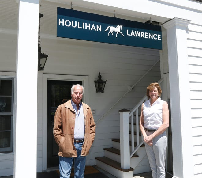 From left, licensed real estate agent John Friend and branch manager Katherine L. Jennings outside their office in Millbrook on May 13, 2020.