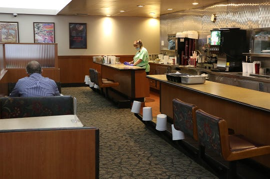 Limited seating options are seen at the Gold 'N Silver Inn diner in Reno on May 13, 2020.