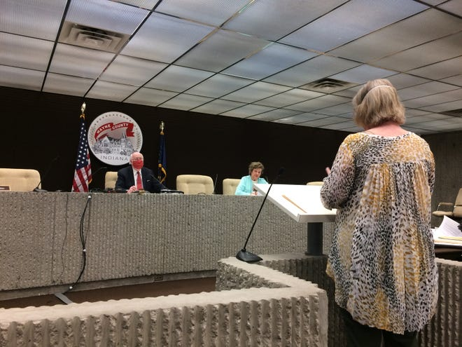 Christine Stinson, director of the Wayne County Health Department, speaks to commissioners Ken Paust and Mary Anne Butters during a May 13, 2020, meeting.