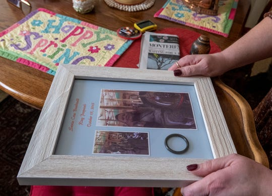 Lori Long, looks at a frame that holds the engagement ring that her fiance Mark Contreras used to propose to her. This photo was taken on Thursday, April 30, 2020.