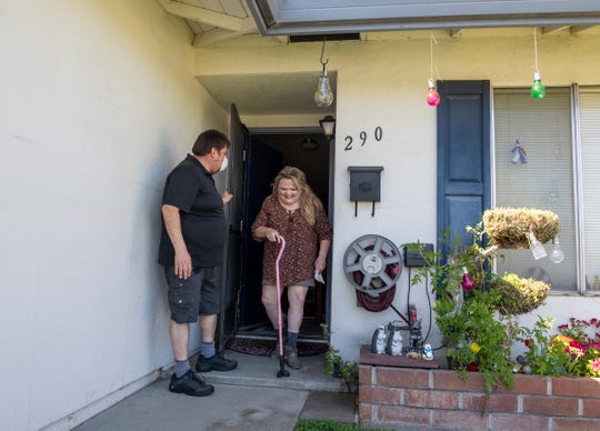 Mark Contreras, holds the door open for his fiancée Lori Long on Thursday, April 30, 2020.
