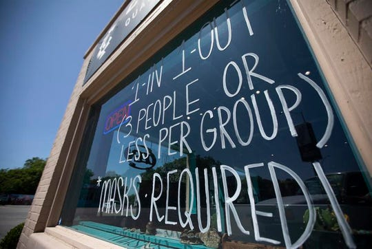 Rules for entering Cosmic Cowboy on South Congress Avenue in Austin are posted on the window.