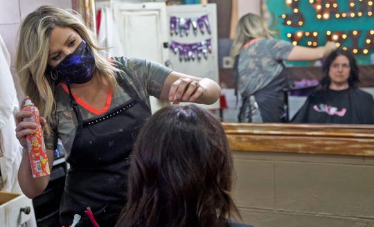 Tori Stubbs, owner of the Burlap and Paisley Boutique and Salon at far left, styles the hair of a client Friday, May 8, 2020 after hair salons were allowed to reopen for business in Texas.