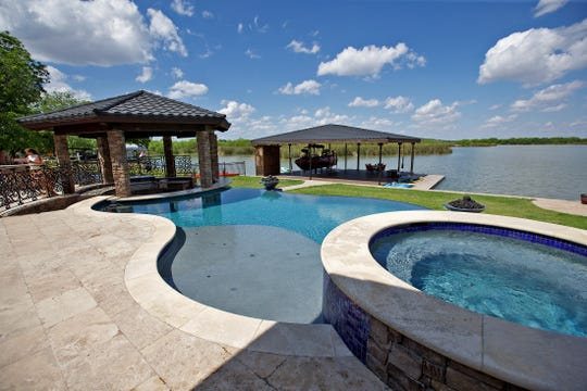 The back yard and pool of the house at 2666 Kings Road on Lake Nasworthy is seen in this Tuesday, May 12, 2020 photo.