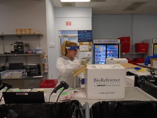 Salisbury University senior and women's soccer player Lydia Narum analyzes tests given to potential COVID-19 patients.