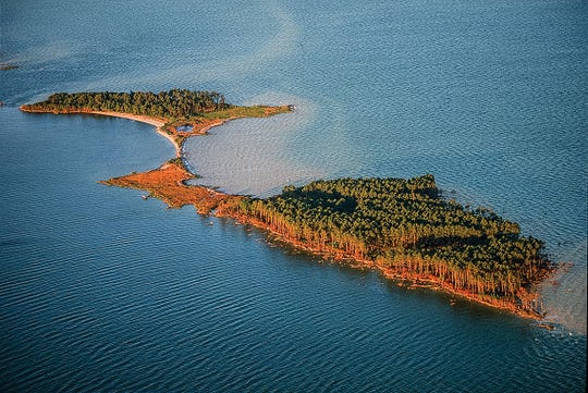 James Island was still somewhat intact in this photo from 1999. Erosion has broken it into three small islands since then and it's disappearing at a great rate.
