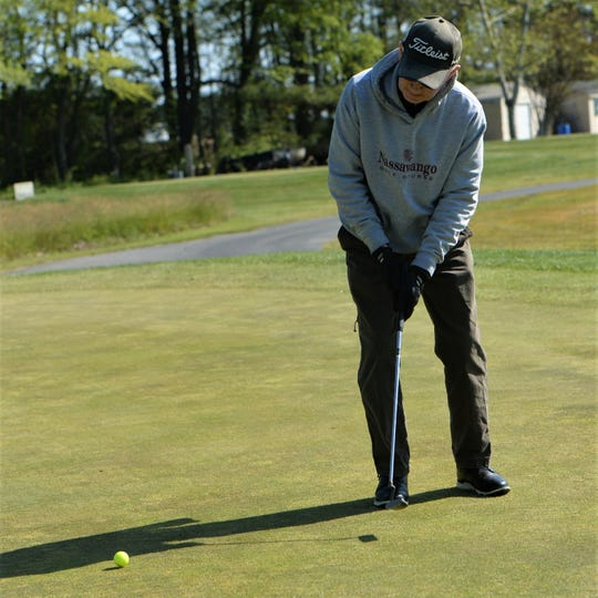 John Hayman putts the ball at the Great Hope Golf Course on Wednesday, May 13, 2020.