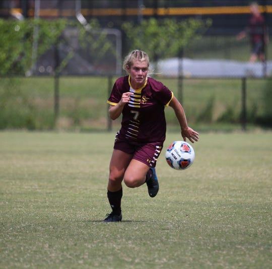 Salisbury University women's soccer player Lyida Narum takes the ball up field for the Sea Gulls.