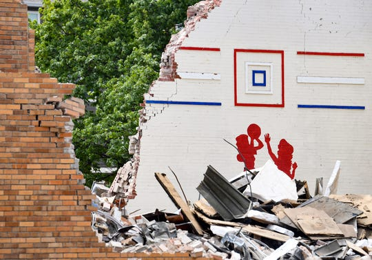 A demolition crew tears down the old Bowden Youth Center on Tuesday, May 12, in Sioux Falls.