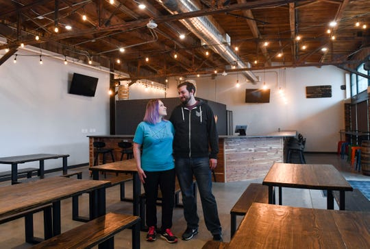 Stacey and Daniel Berry stand in the new Covert Cellars location on Wednesday, May 13, on 8th Street in Sioux Falls.