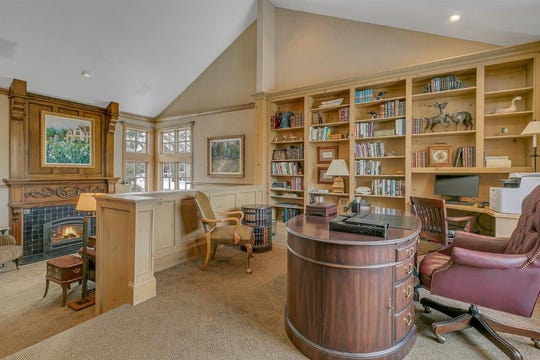 The main floor features an executive den that offers one full wall of floor-to-ceiling built-in bookcases.