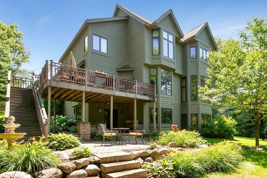The upper level deck offers plenty of space for entertaining and enjoying the outdoors.