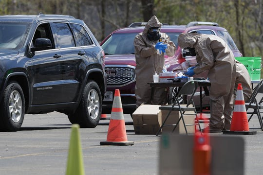 Wisconsin National Guard members conduct tests for COVID-19 on Monday, May 11, 2020, at the Portage County Health and Human Services building in Stevens Point.