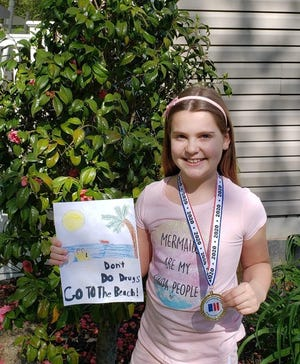 Cassidy Curtin of Maurice River Township School recommends going to the beach in her stay drug-free message. She was a finalist in the Partnership for a Drug-Free New Jersey's Design a Fourth Grade Folder contest.