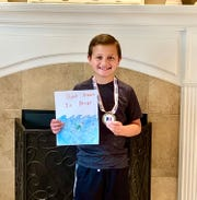 "Dominic Anderson of St. Mary School in Vineland shared the message, ""Don't drown in drugs,"" on his entry for the Partnership for a Drug-Free New Jersey's Design a Fourth Grade Folder contest. He was a finalist in the contest."