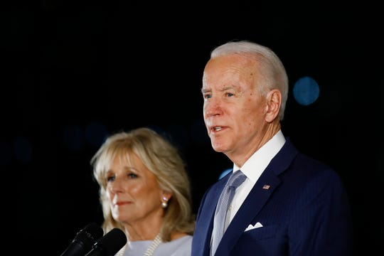 Democratic presidential candidate Joe Biden, accompanied by his wife Jill, speaks to members of the press at the National Constitution Center in Philadelphia in March.