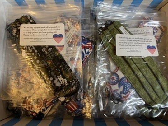Hand-sewn masks from the Muskingum County Chapter of the Daughters of the American Revolution members are packaged for distribution to those in need of personal protective equipment.