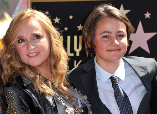 Melissa Etheridge poses with her son Beckett during her Walk of Fame ceremony held at the Hard Rock Cafe in Hollywood on Sept. 27, 2011. Beckett Cypher, the singer's son with former partner Julie Cypher, has died at the age of 21.
