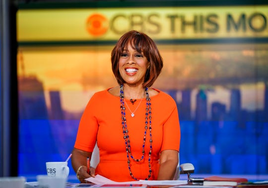 """Gayle King layers necklaces during an episode of """"CBS This Morning"""" broadcast in studio."""