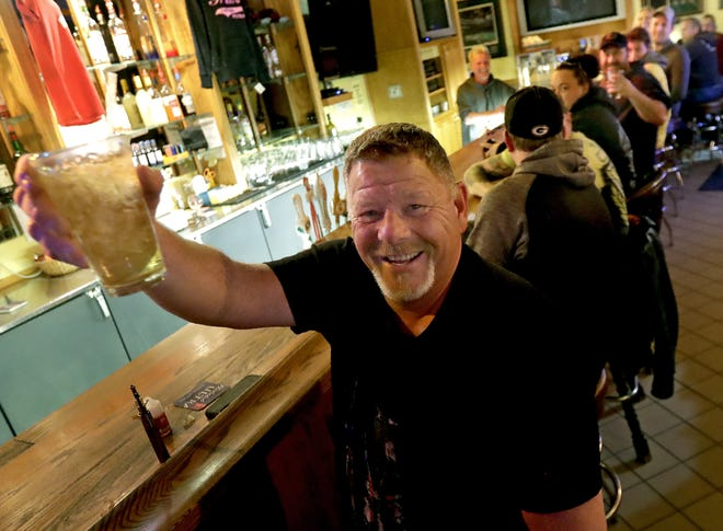 Marvin Radtke toasts the reopening of Friends & Neighbors bar in Appleton late Wednesday after the Wisconsin Supreme Court struck down Gov. Tony Evers' safer-at-home order. Appleton since has extended the order until May 20.