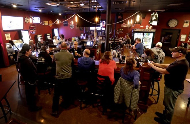 The Dairyland Brew Pub opens to patrons following the Wisconsin Supreme Court's decision to strike down Gov. Tony Evers' safer-at-home order on Wednesday, May 13, 2020 in Appleton, Wis.