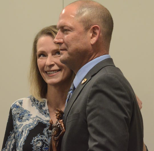 Battle Creek Police Detective Randy Reinstein and his wife, Laura, at a ceremony for his selection as Officer of the Year.  Trace Christenson/The Enquirer