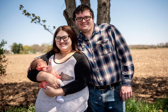 Ivy Kruger and her fiancé Jon Bell pose for a portrait with their daughter Jilliana Bell on Wednesday, May 6, 2020 at their home in Athens, Mich. Jilliana was born during the COVID-19 pandemic on April 29, 2020.
