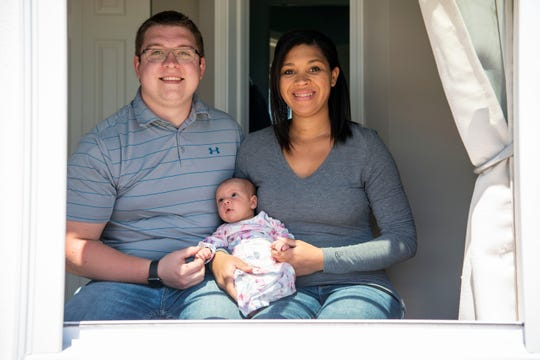 Daniel and Mariah Harrison pose for a portrait with their daughter Myla on Monday, May 4, 2020 in Battle Creek, Mich. Myla was born during the COVID-19 pandemic on April 9, 2020.