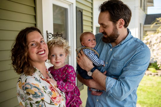 Laura and Phil Voss pose for a portrait with their children Johanna, 2, and newborn Ethan on Wednesday, May 6, 2020 at their home in Marshall, Mich. Ethan was born during the COVID-19 pandemic on April 5, 2020.