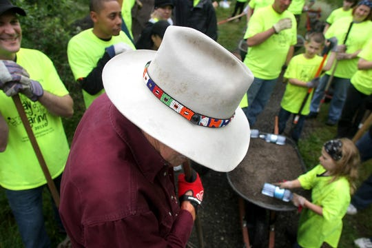 Tex Lewis's iconic hat during the Day of Caring in 2013.