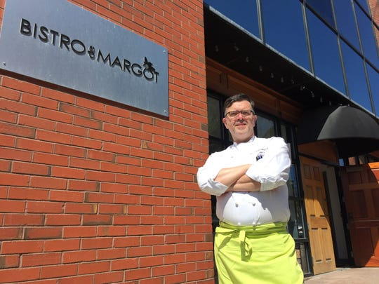Chef/owner Herve Mahe stands outside Bistro de Margot, his restaurant on College Street in Burlington, on May 13, 2020.