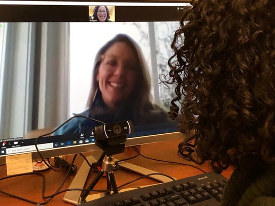 Diana Clayton, NP (on screen) and Andrea Solomon, PA, of Community Health Centers of Burlington, communicate with one another via their telehealth technology.