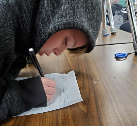 Kaffie Middle School student Ethan Long creates a survey for Prevent-A, a product that he and his teammates conceptualized to prevent gum from sticking to surfaces. The team's business plan recently won the Biz Kid$ financial literacy competition.