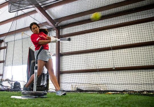 Karina Trevino practices hitting with her brother Joshua Trevino in Robstown on Wednesday, May 13, 2020.
