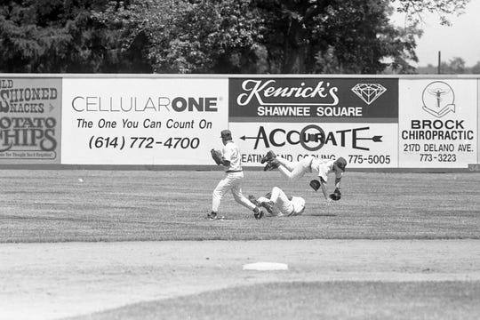 Chris Bruce, left, Sam Young, center, and Jeremy Tuttle converge on a fly ball in a game against Cadiz. Unioto defeated Cadiz 22-12 in the Division III regional semifinal in 1994.
