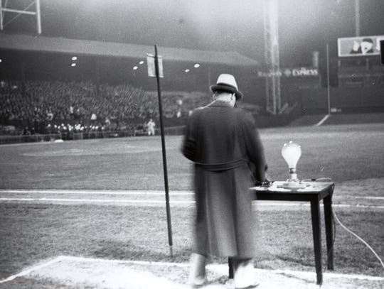 Cincinnati Reds general manager Larry MacPhail turns on the lights at Crosley Field for the big league's first night game on May 24, 1935.