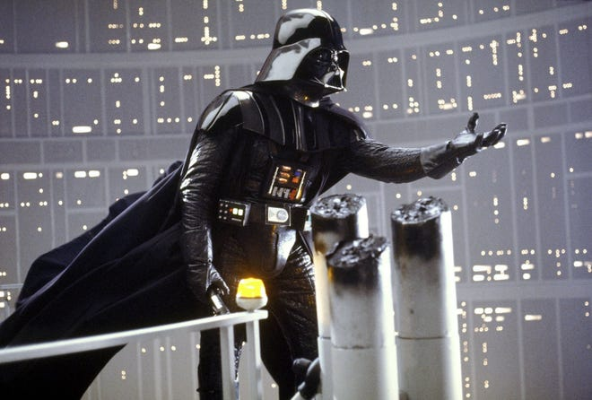 """Darth Vader is shown in a scene from Lucasfilm's """"Star Wars: Episode V, The Empire Strikes Back,"""" in this undated promotional photo. The Star Wars Day celebration gets underway Tuesday at 200 South in downtown Pensacola."""