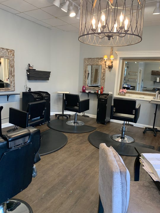 """Salon Rhonda has been freshly painted and sanitized in anticipation of reopening. """"It's spotless right now,"""" said owner Rhonda DeWine. """"Basically, it looks like the day I opened it."""""""