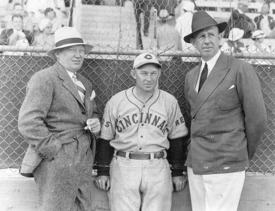 MARCH 14, 1935: Reds general manager Larry MacPhail, manager Chuck Dressen, and owner Powel Crosley Jr. have time to pose for the photographer at the training camp at Tampa. They take this time out from a discussion of the Red prospects of 1935.